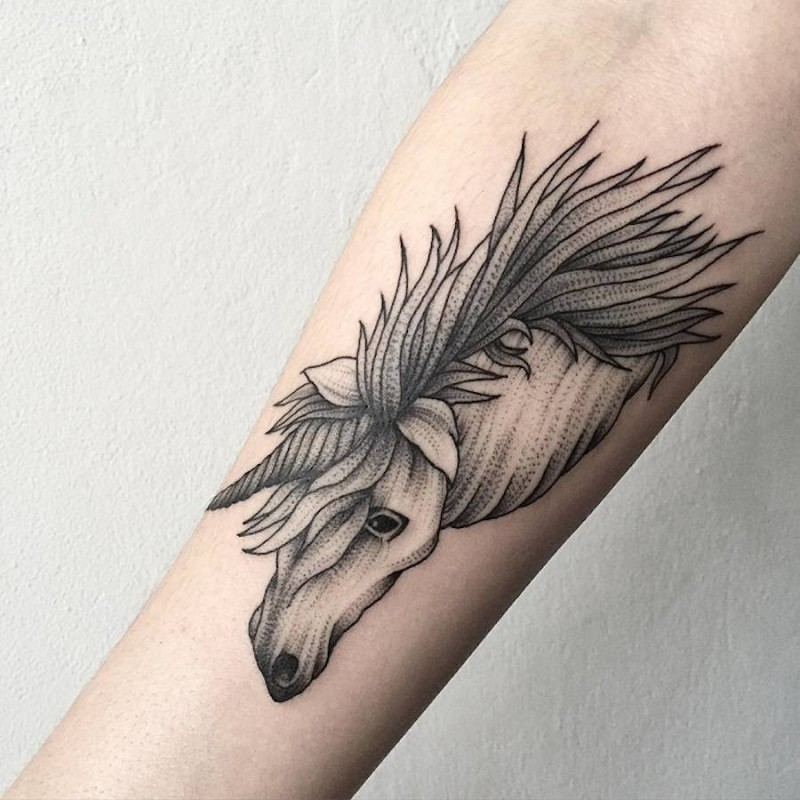 Little black ink slim forearm tattoo of unicorn head