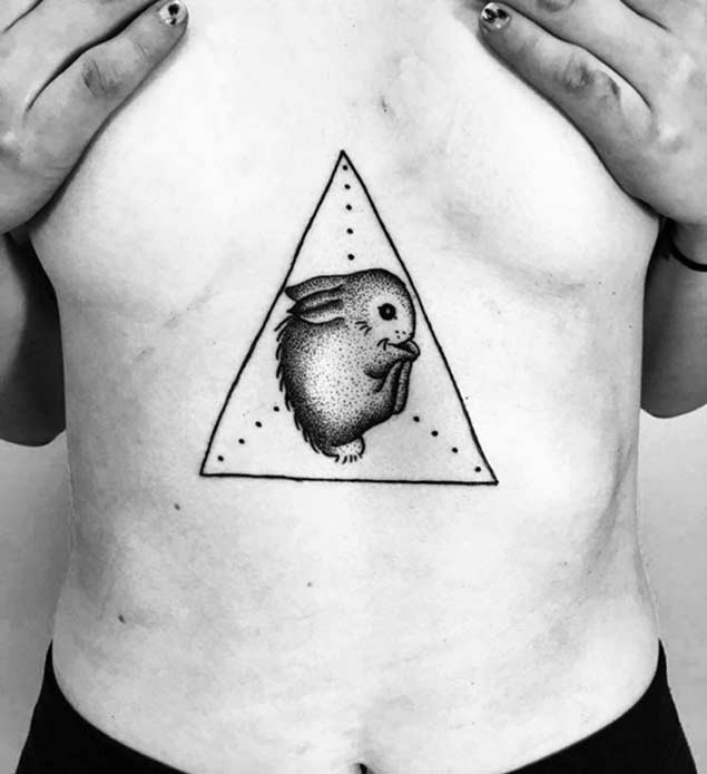 Little black ink sweet rabbit tattoo on belly with triangle