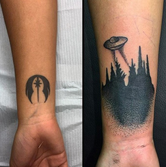 Little black ink various mystical tattoos with alien ship and symbol on wrist