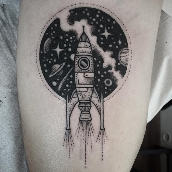 Little black ink vintage like old space rocket tattoo stylized with open space