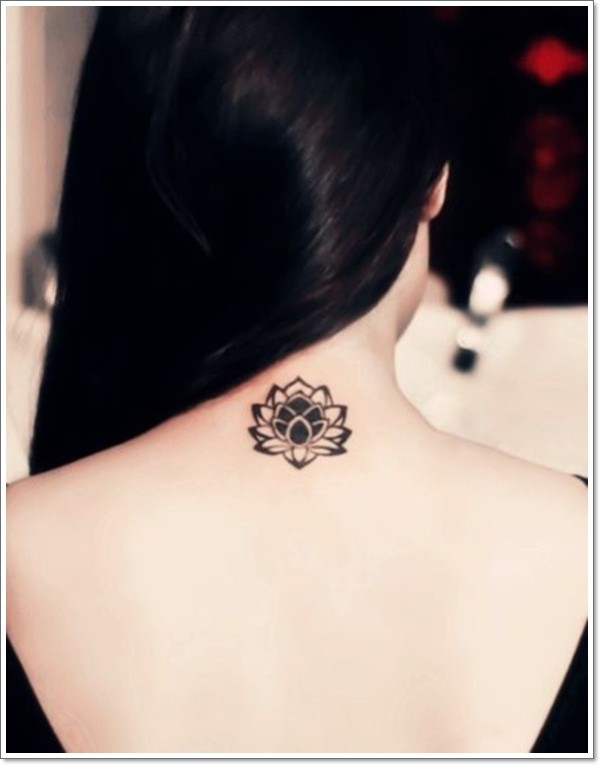 Little black lotus flower tattoo on back