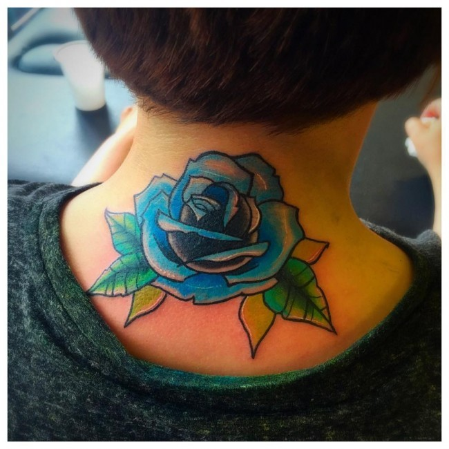Little blue colored old school rose flower tattoo on neck