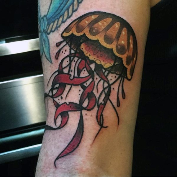 Little cartoon like colored funny jellyfish tattoo on arm