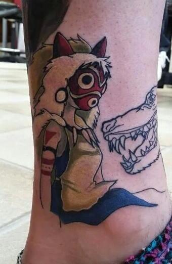 Little cartoon like impressive ankle tattoo of woman in mask