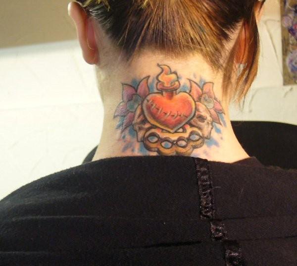 Little cartoon style colored burning heart tattoo on neck with skulls