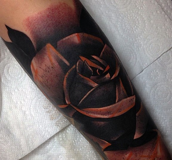 Little colored dark rose tattoo on arm