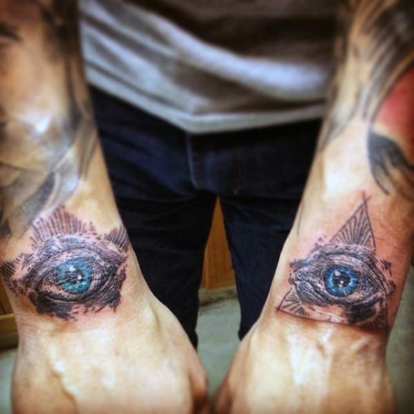 Little colored Masonic style pyramids tattoo on wrists