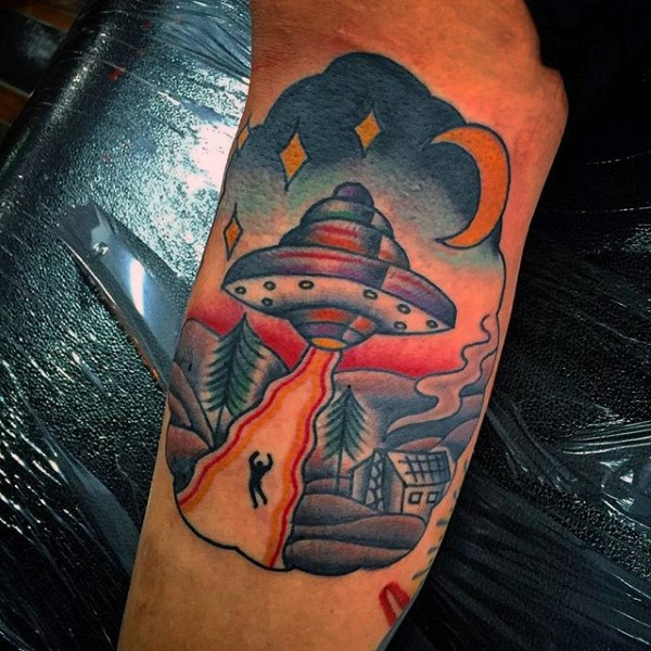 Little colorful alien ship with human in night sky tattoo on arm