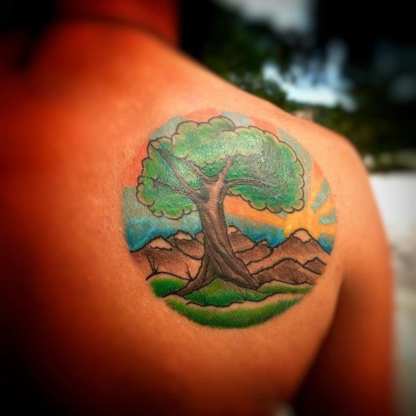 Little colorful big lonely tree tattoo on shoulder stylized with mountains