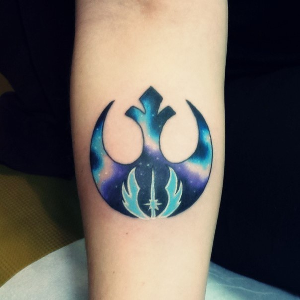 Little colorful Star Wars Rebel Alliance emblem tattoo of forearm stylized with little Jedi Order emblem