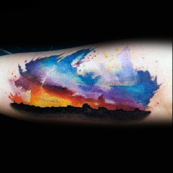 Little colorful sunset with mountains tattoo on leg