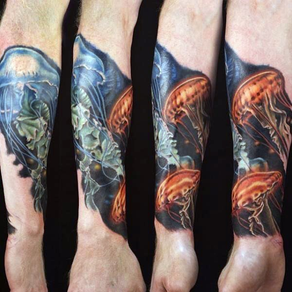 Little colorful very detailed jellyfish tattoo on wrist