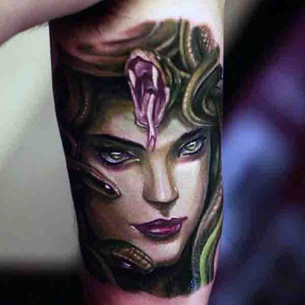 Little colorful very realistic Medusa tattoo on arm