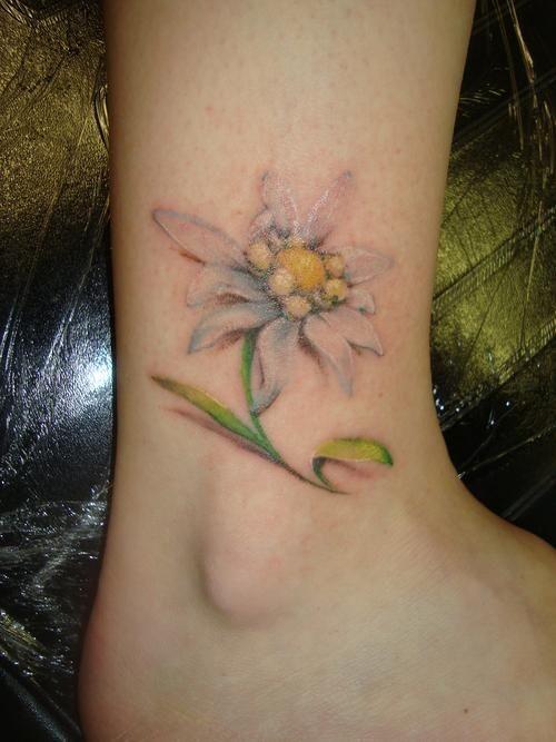 Little cute flower tattoo on foot