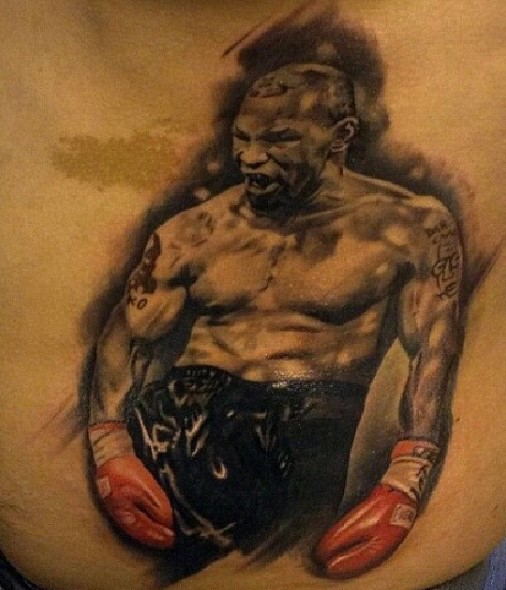 little detailed and colored mike tyson portrait tattoo on back. Black Bedroom Furniture Sets. Home Design Ideas
