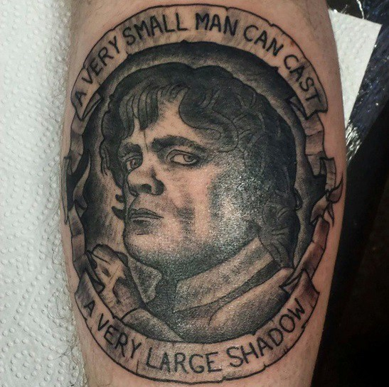 Little famous Game of Thrones hero black ink portrait tattoo with lettering