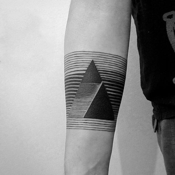 Little geometrical black and white tattoo on arm