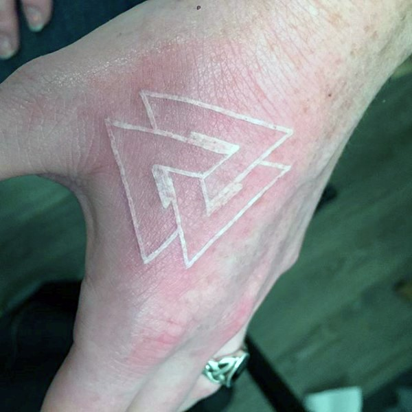 Little geometrical white ink tattoo on hand