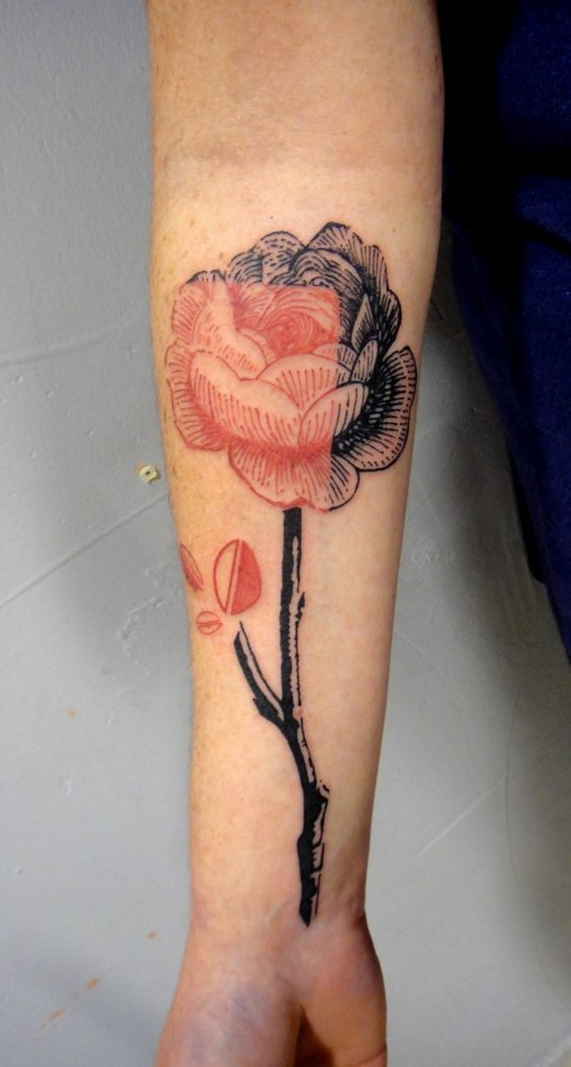 Little half colored realistic flower tattoo on arm