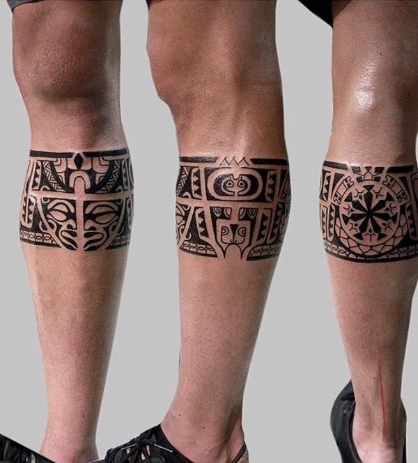 Little interesting painted leg band shaped tattoo stylized with tribal ornaments