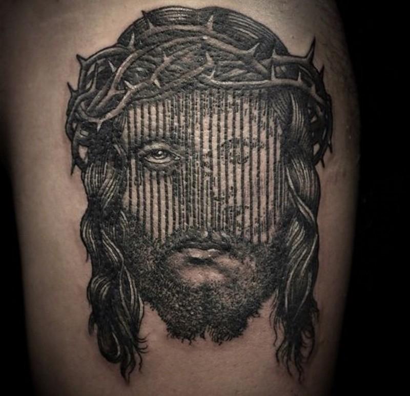 Little Jesus like black ink portrait tattoo on thigh