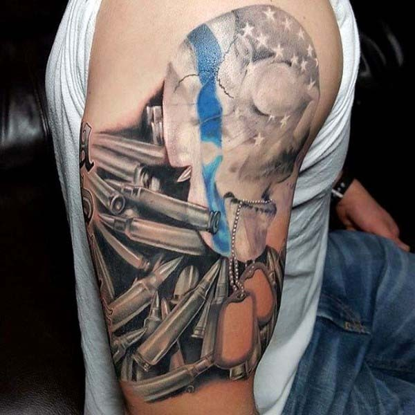 Little multicolored American native military shoulder tattoo with skull and bullets