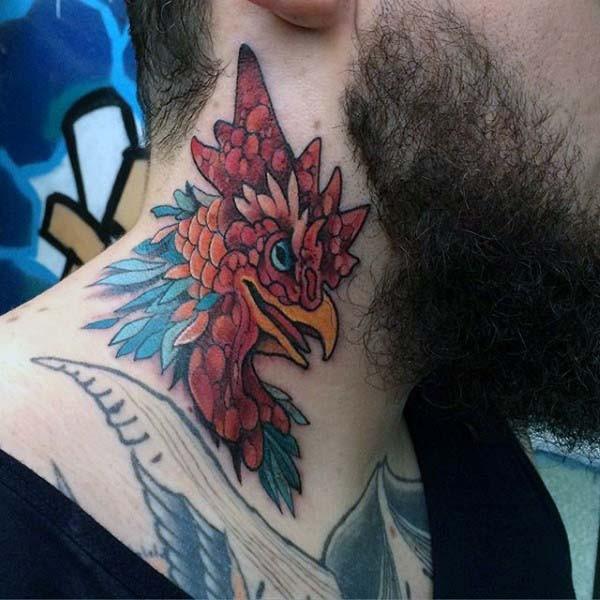 Little multicolored cock head tattoo on neck