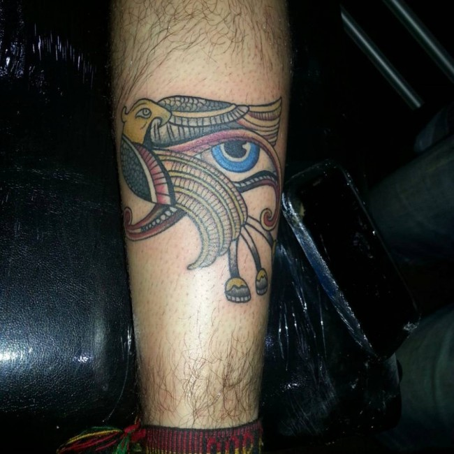 Little multicolored eagle tattoo on leg with Eye of Horus symbol