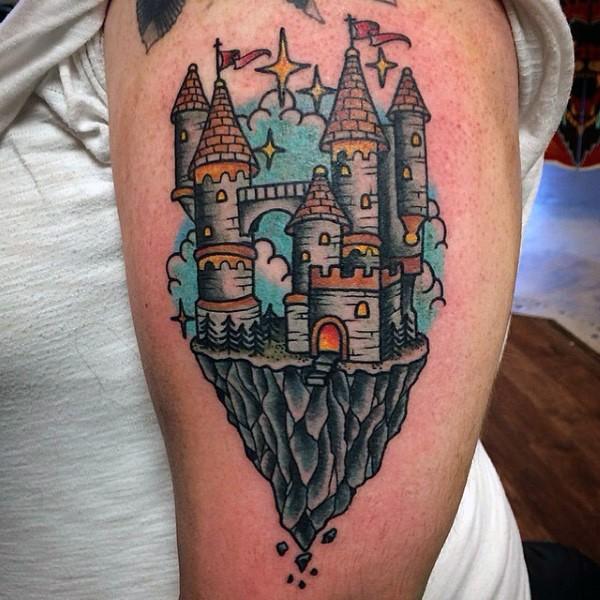 Little multicolored fantasy castle tattoo on shoulder area
