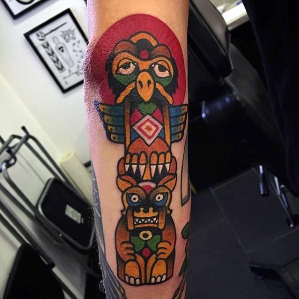 Little multicolored tribal gods statue tattoo on arm