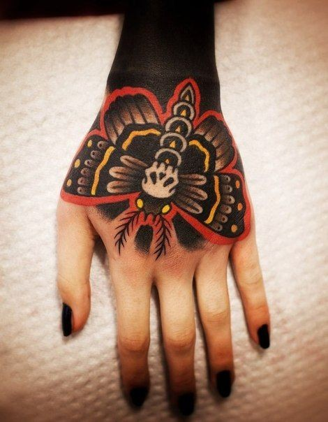 Little mystical colored hand tattoo of night butterfly stylized with skull