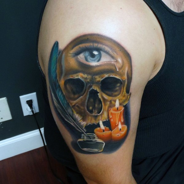 Little mystical pained colored skull with one eye and candles shoulder tattoo