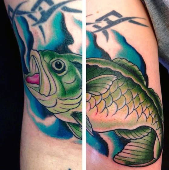 Little natural colored underwater fish tattoo on arm