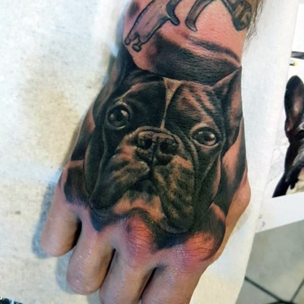 Little natural looking black ink dog portrait tattoo on arm