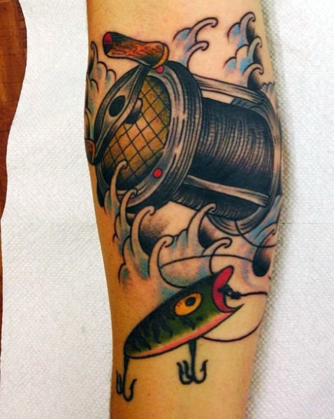 Little natural looking colored fishing coil with lure tattoo on arm