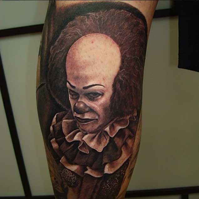 Little natural looking colored terrifying clown tattoo on leg