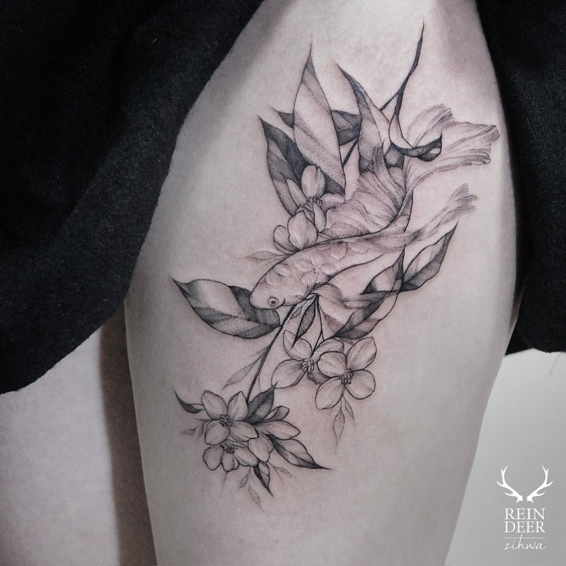 Little nice looking thigh tattoo of fishes and flowers