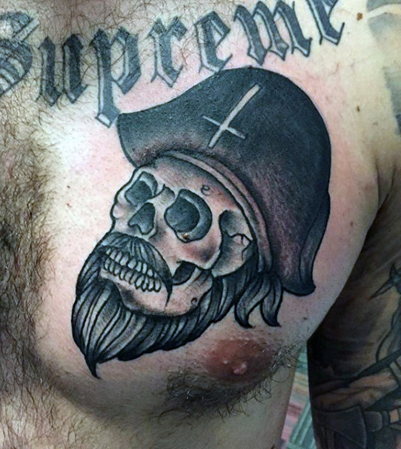 Little old pirate skull tattoo on chest