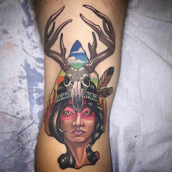 Little Old school style colored Indian woman tattoo on leg stylized with animal skull