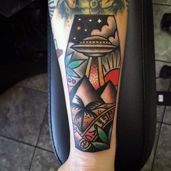 Little original designed little coffin shaped tattoo with alien ship and pyramids on arm