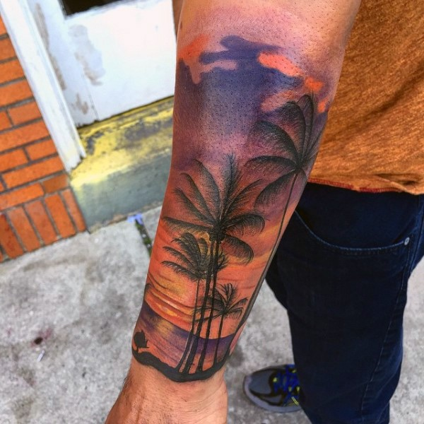 Little romantic looking colorful sunset with palm trees tattoo on wrist
