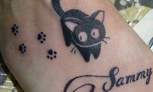 Little black cat with paw prints tattoo