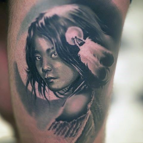 Little very detailed natural looking thigh tattoo with Indian girl portrait