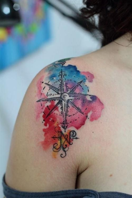 Little watercolor like painted nautical star tattoo on shoulder