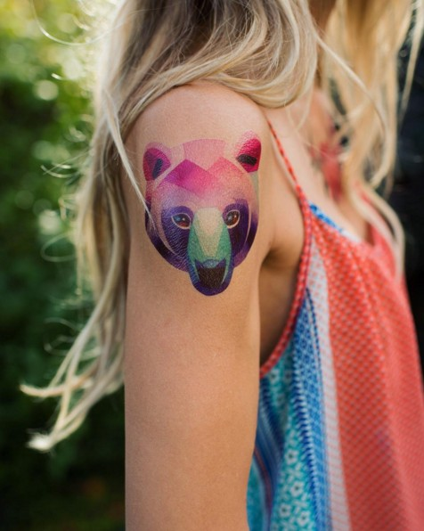 Little watercolor painted shoulder tattoo on bear head