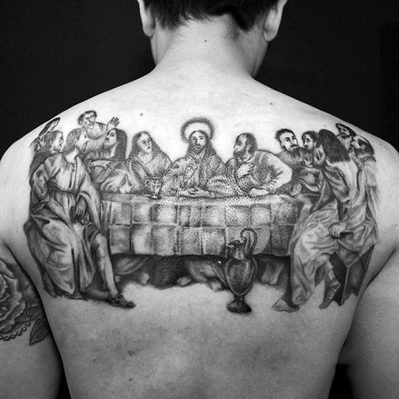 Lord&quots Supper detailed tattoo on upper back