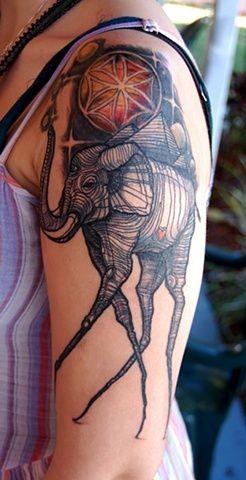 Lovely Salvador Dali theme tattoo on shoulder