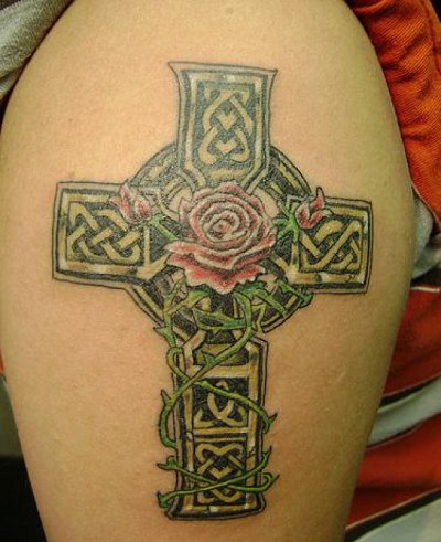 Lovely celtic irish cross with red rose tattoo on shoulder