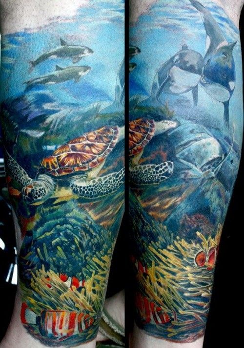 Lovely coloured ocean tattoo on arm