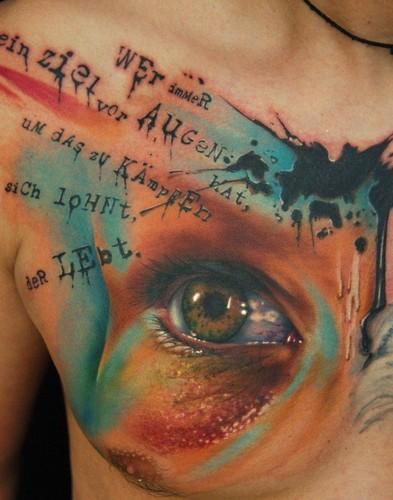 Lovely eye trash polka tattoo on chest